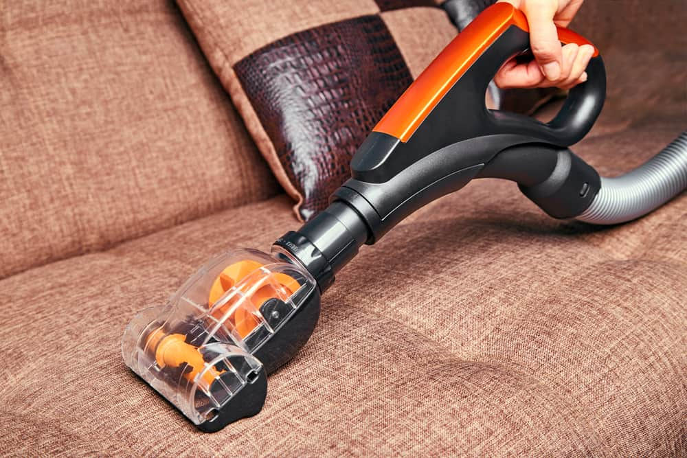 Cleaning sofa with a handheld vacuum