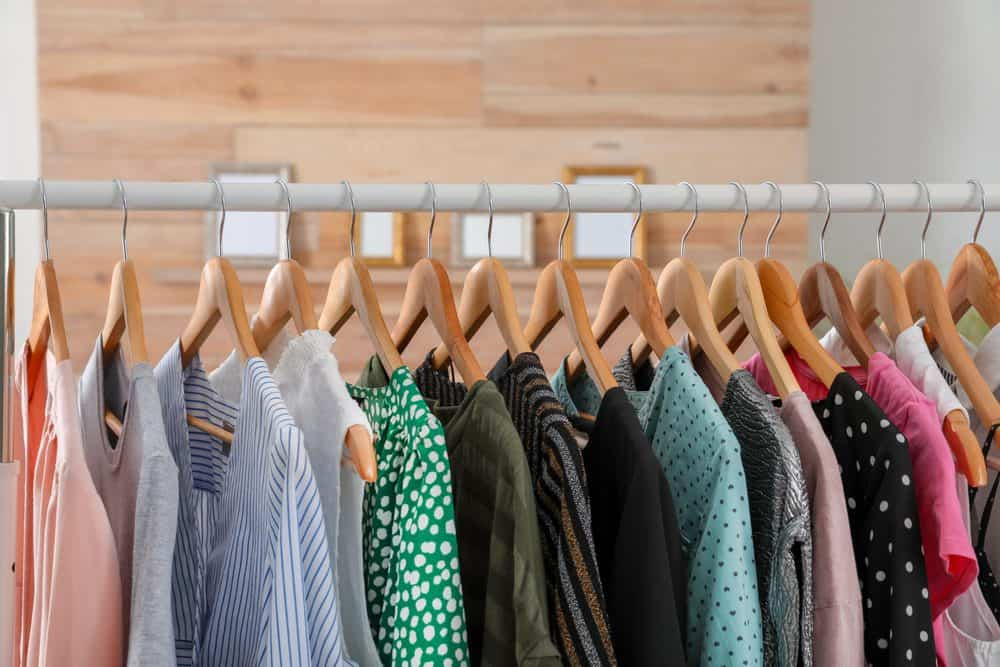 A stack of clothes hanging on a rack