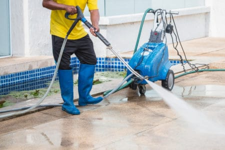 man preparing to winterize his pressure washer outdoor