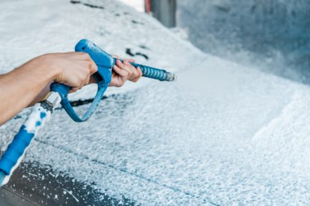 Pressure washing with spray gun